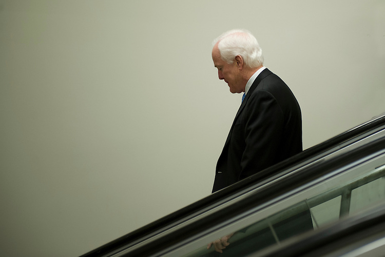 UNITED STATES - : Sen. John Cornyn, R-TX., talks with reporters as he walks through the Senate Subway to the U.S. Capitol on the way to the Caucus luncheons on April 18, 2013.  (Photo By Douglas Graham/CQ Roll Call)