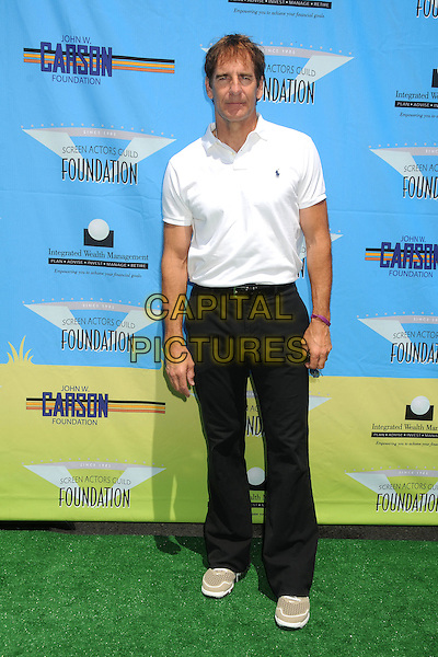 Scott Bakula.SAG Foundation LA Golf Classic 2012 held at Lakeside Golf Club, Burbank, California, USA..June 11th, 2012.full length polo shirt top trousers white black.CAP/ADM/BP.©Byron Purvis/AdMedia/Capital Pictures.