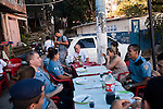 Pacification police officers have lunch in Chapeu Manguiera, a small, hillside community situated above Leme and Copacabana neighborhoods, in Rio de Janeiro, Brazil, on May 20, 2013. About 4,000 people live in the communities, along with neighboring community of Babylonia, which received UPP (Police Pacifying Unit) in 2009.