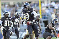 17 September 2011:  FIU defensive line Paul Crawford (92) takes a fumble recovery to the end zone while being pursued by UCF wide receiver Khymest Williams (82) in the first quarter as the FIU Golden Panthers defeated the University of Central Florida Golden Knights, 17-10, at FIU Stadium in Miami, Florida.  Officials later negated the fumble.