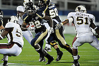 22 November 2008:  FIU running back Julian Reams (32) breaks through an opening in the ULM 31-27 victory over FIU at FIU Stadium in Miami, Florida.