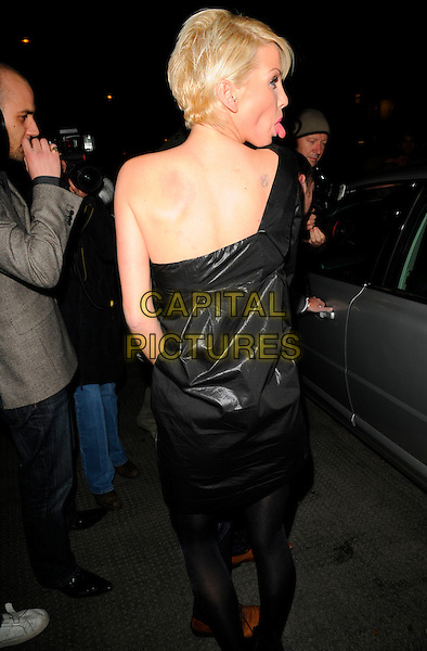 SARAH HARDING (Girls Aloud) .At the Samsung & Cystic Fibrosis Trust Gala Dinner, Bluebird Restaurant, London, England, February 28th 2008..full length black dress back rear behind sticking tongue out funny one shoulder.CAP/CAN.?Can Nguyen/Capital Pictures