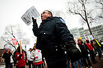 Correctional officer Tom Jensen protests outside the  Wisconsin State Capitol over a bill that threatens to strip collective bargaining rights in Madison, Wisconsin, February 26, 2011. Crowds swelled Saturday as protests enter their 12th day.