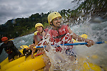 TURRIALBA, COSTA RICA- JANUARY 2, 2009:  Glenn Sáenz (R), 23, of Jersey City; and his cousins Gaby Quirós (C), 21, and Fernanda Obando (2L), 20, of San Jose; white-water raft on the Pacuare River with Rios Tropicales on January 2, 2009 in Turrialba, Costa Rica.    (Photo by Michael Nagle)