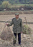 "Chinese Farmer / ex-soldier.  Saw him coming out of wooded area where the Water Buffalo are behind him.  Appears to be a retired Red Army soldier. Seem to be a happy man.  Location is the Guilin country side, in Southern China.  The airfield of Chinault's 1939 ""Flying Tigers"" was just outside Guilin."