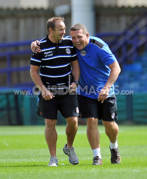 First team coaches Darren Edwards and Toby Booth share a joke prior to the match. Pre-season friendly match, between Bath Rugby and the Scarlets on August 16, 2014 at the Recreation Ground in Bath, England. Photo by: Patrick Khachfe / Onside Images