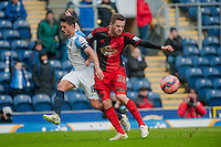 BLACKBURN, ENGLAND - JANUARY 24:  Jason Lowe of Blackburn Rovers  and Gylfi Sigurosson of Swansea City battle for the ball  during the FA Cup Fourth Round match between Blackburn Rovers and Swansea City at Ewood park on January 24, 2015 in Blackburn, England.  (Photo by Athena Pictures/Getty Images)