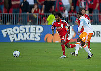 01 July 2010:  Houston Dynamo midfielder Lovel Palmer #22 and Toronto FC midfielder Julian de Guzman #6 in action during a game between the Houston Dynamo and the Toronto FC at BMO Field in Toronto..Final score was 1-1....