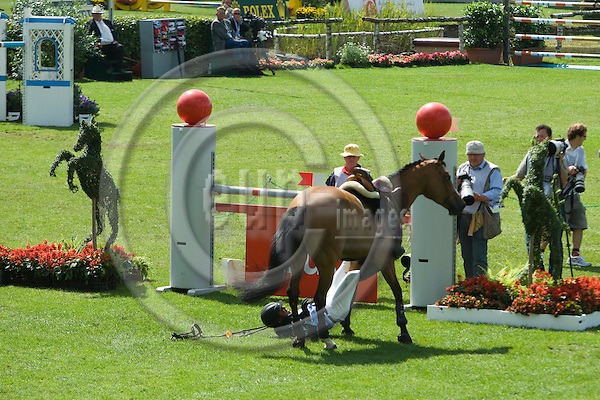 AACHEN - GERMANY - 04 JULY 2008 --  World Equestrian Festival, CHIO Aachen 2008 -- Brazilian Alvaro MIRANDA falling with his horse Ad Ornella trying to jump this fence during the Prize of Northrhine-Westphalia jumping competition of the World Equestrian Festival CHIO in Aachen. He got entangled with his foot caught in the stirrup and was taken to hospital by ambulance. The horse seemed to be fine after being calmed down. Photo: Erik Luntang/EUP-IMAGES..