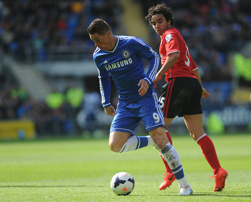 Chelsea's Fernando Torres vies for possession with Cardiff City's Fabio Da Silva<br /> <br /> Photographer Ashley Crowden/CameraSport<br /> <br /> Football - Barclays Premiership - Cardiff City v Chelsea - Sunday 11th May 2014 - Cardifff City Stadium - Cardiff<br /> <br /> &copy; CameraSport - 43 Linden Ave. Countesthorpe. Leicester. England. LE8 5PG - Tel: +44 (0) 116 277 4147 - admin@camerasport.com - www.camerasport.com