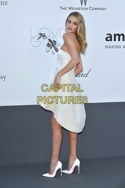 Rosie Huntington-Whiteley.amfAR 20th Cinema Against Aids Gala at the Hotel du Cap, Antibes, during the 66th Cannes Film Festival, France 23rd May 2013..full length strapless white dress cream hands side back over shoulder rear behind shoes.CAP/PL.©Phil Loftus/Capital Pictures.