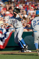 UCLA 1B Dean Espy records a putout in Game Two of the NCAA Division One Men's College World Series Finals on June 29th, 2010 at Johnny Rosenblatt Stadium in Omaha, Nebraska.  (Photo by Andrew Woolley / Four Seam Images)
