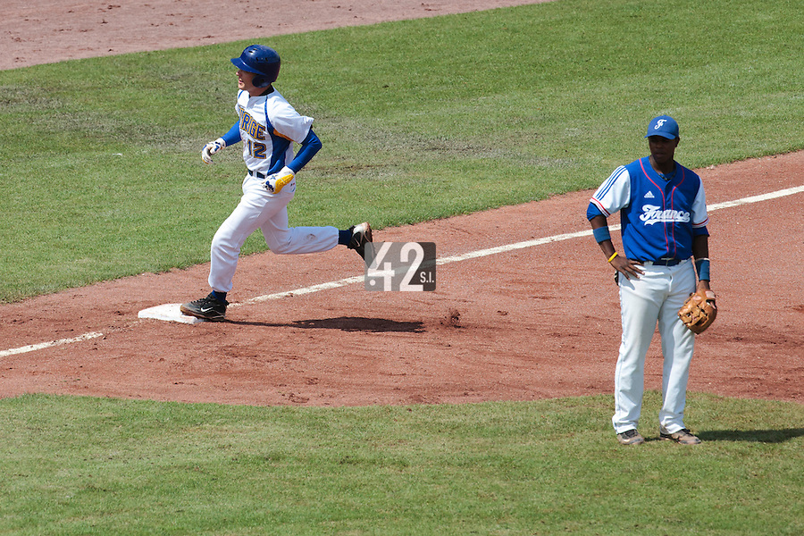 30 july 2010: Rickard Leander of Sweden runs the bases past Omar Williams, after his 2 runs home run during Sweden 3-2 win over France, in day 6 of the 2010 European Championship Seniors, at TV Cannstatt ballpark, in Stuttgart, Germany.