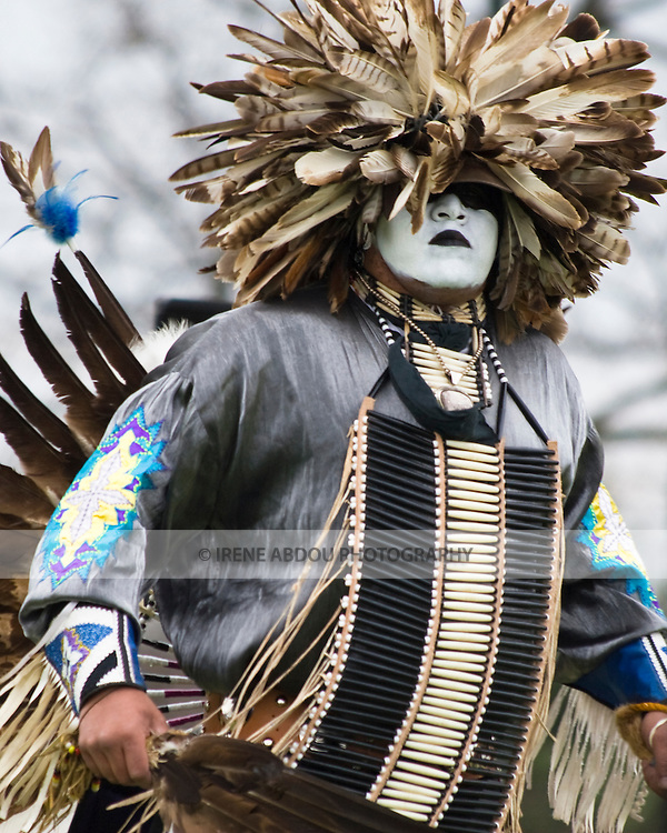 "Charles Hankinson (Eagle Tail), a Native American from the Micmac tribe of Canada, dances in full traditional regalia at the Healing Horse Spirit PowWow. His face paint was ""gifted"" to him by his grandfather."
