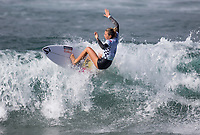 Huntington Beach, CA - Saturday August 4, 2018: Coco Ho in action during a World Surf League (WSL) World Championship Tour (WCT) Round 3 heat at the 2018 Vans U.S. Open of Surfing on South side of the Huntington Beach pier.
