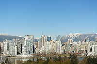 Vancouver skyline 2017 with False Creek in foreground snow-capped North Shore mountains in back, Vancouver, British Columbia, Canada