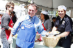 April 2, 2010: Brian Quintana and Los Angeles Police Chief Charlie Beck at the LA Mission Easter Luncheon event for the homeless in Los Angeles, California. .Photo by Nina Prommer/Milestone Photo.