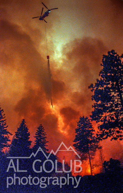 August 19, 1992 Angels Camp, California -- Old Gulch Fire— Helicopter drops water on spot fire near Highway 4.  The Old Gulch Fire raged over some 18,000 acres, destroying 42 homes while threatening the Mother Lode communities of Murphys, Sheep Ranch, Avery and Forest Meadows.