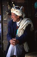 old merchant of jambiya knives in his shop in San'a Yemen