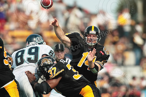 September 2, 2002; Hamilton, Ontario, Canada; Hamilton Tiger-Cats quarterback (14) Danny McManus in action during the Labour Day Classic against the Toronto Argonauts during the 2002 season at Ivor Wynne Stadium. Photo © Ron Scheffler. MANDATORY CREDIT