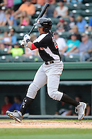 First baseman Ronald Guzman (22) of the Hickory Crawdads bats in a game against the Greenville Drive on Sunday, June 9, 2013, at Fluor Field at the West End in Greenville, South Carolina. Guzman is the No. 17 prospect of the Texas Rangers, according to Baseball America. Hickory won, 6-3. (Tom Priddy/Four Seam Images)
