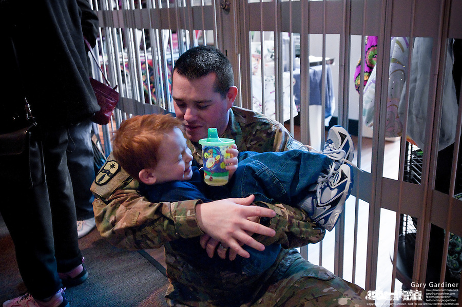 U.S. Army Pfc. Josh Wholaver tussles with his four-year-old son, Noah, after returning from a tour in Afghanistan. Wholaver belongs to the 684th Medical Unit of the Ohio National Guard, a unit that had once operated out of the Armory in Uptown Westerville.