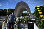 HIROSHIMA, JAPAN - AUGUST 05: A man lays flowers and pray for the atomic bomb victims in front of the cenotaph at the Hiroshima Peace Memorial Park in Hiroshima, western Japan on August 5, 2019, a day before the 74th anniversary ceremony of the attack. (Photo: Richard Atrero de Guzman/ AFLO)