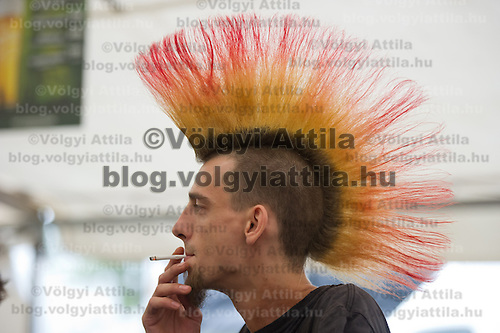 Participant enjoys his time on Sziget festival held in Budapest, Hungary on August 07, 2011. ATTILA VOLGYI