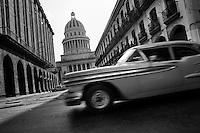 An American classsic car from the 1950s passes along the street in front of The Capitol (El Capitolio), Havana, Cuba, 15 August 2008. El Capitolio is a neoclassical building modeled after the U.S. Capitol building in Washington and the Pantheon in Paris. Completed in 1929, it was home to Cuban legislature (Palace of Congress). Since the Cuban Revolution, The Capitol has become the seat of the Ministry of Science, Technology, and the Environment. The Capitol is one of Havana's most popular tourist attractions.