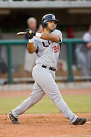 Pedro Alvarez #24 of Team USA follows through on his swing versus Team Canada at the USA Baseball National Training Center, September 4, 2009 in Cary, North Carolina.  (Photo by Brian Westerholt / Four Seam Images)