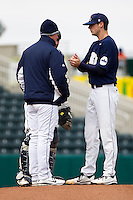Bryce Smolen (44) of the Oral Roberts Golden Eagles has a conversation with catcher Brett Burch (20) and head coach Rob Walton during a game against the Missouri State Bears on March 27, 2011 at Hammons Field in Springfield, Missouri.  Photo By David Welker/Four Seam Images