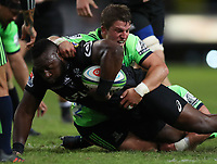 DURBAN, SOUTH AFRICA - MAY 05: Teihorangi Walden of the Pulse Energy Highlanders tackling Tendai Beast Mtawarira during the Super Rugby match between Cell C Sharks and Highlanders at Jonsson Kings Park Stadium in Durban, South Africa on Saturday, 5 May 2018. Photo: Steve Haag / stevehaagsports.com