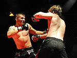 Local man Alex Muzicuks (left) pictured at the Cage Fighting event at the TLT. Photo: Colin Bell/pressphotos.ie
