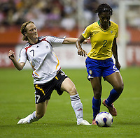 German midfielder (7) Melanie Behringer moves in on Brazil defender (2) Elaine. Germany (GER) defeated Brazil 2-0 in the finals of the Women's World Cup China 2007 at Shanghai Hongkou Football Stadium, Shanghai, China, on September 30, 2007.