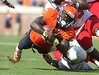 Virginia running back Kevin Parks (25) stretches his body towards the goal line during the football game Saturday Oct. 5, 2013 at Scott Stadium in Charlottesville, VA. Ball State defeated Virginia 48-27. Photo/The Daily Progress/Andrew Shurtleff
