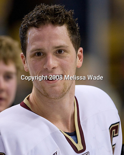 Mike Brennan (BC 4) - The Boston College Eagles defeated the Harvard University Crimson 6-5 in overtime on Monday, February 11, 2008, to win the 2008 Beanpot at the TD Banknorth Garden in Boston, Massachusetts. Mike Brennan, senior defenseman, captains the Boston College Eagles.  He wore the A his junior year and is a free agent.