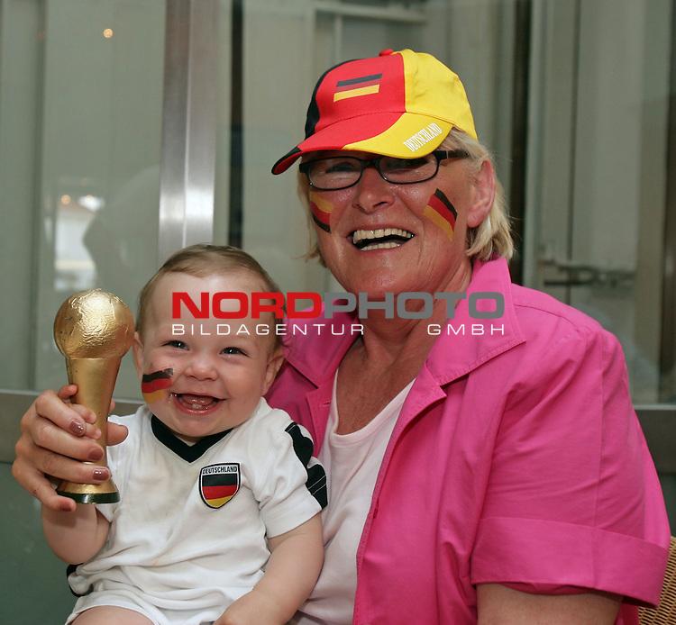 FIFA WM 2006 -  Semi Finals / Halbfinale<br /> Play    #61 (04-Juli) - Deutschland - Italien<br /> <br /> Feature Fan Stimmung von der Nordseeinsel Norderney<br /> <br /> Auch Klein Enzo ( 3 Monate aus Frankfurt ) ist sich sicher, dass der Pokal nach Deutschland geh&ouml;rt. Hier mit seiner Oma Theresa aus M&uuml;nster<br /> <br /> Foto &copy; nordphoto <br /> <br />  *** Local Caption ***
