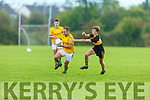 John Mitchells Oliver Coffey in possession as Dr Crokes Mark O'Shea tries to close him down in the Molyneaux Cup Final on Saturday in Castleisland.
