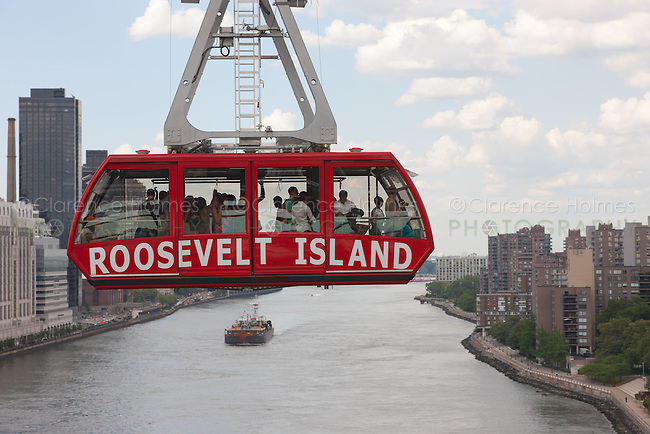 The newly renovated Roosevelt Island Tram crosses over the East River from Manhattan headed for Roosevelt Island.