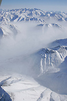 Tuesday March 6, 2007   The wind blows the snow off the mountains in the Rainy Pass area of the Alaska Range on  Tuesday