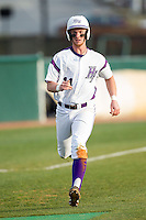 Spencer Angelis (11) of the High Point Panthers hustles down the third base line on his way to scoring a run against the Coastal Carolina Chanticleers at Willard Stadium on March 14, 2014 in High Point, North Carolina.  The Panthers defeated the Chanticleers 3-0.  (Brian Westerholt/Four Seam Images)