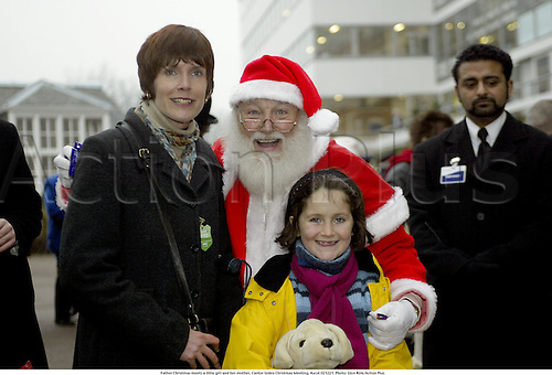Father Christmas meets a little girl and her mother, Cantor Index Christmas Meeting, Ascot 021221. Photo: Glyn Kirk/Action Plus...2002.horse racing.santa national hunt