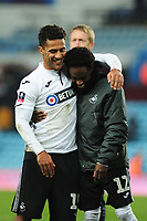 Wayne Routledge (left) laughs with Nathan Dyer (right) of Swansea City at full time during the FA Cup Third Round match between Aston Villa and Swansea City at Villa Park in Birmingham, England, UK. Saturday 05 January 2019