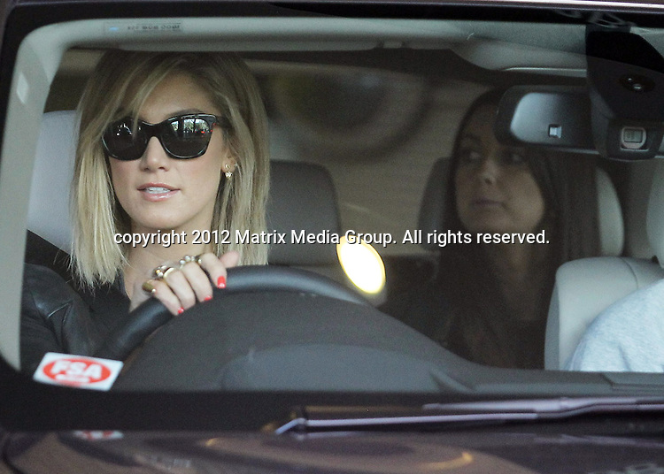 26 JUNE 2013 SYDNEY AUSTRALIA <br /> <br /> NON EXCLUSIVE <br /> <br /> Delta Goodrem pictured leaving the Sheraton Hotel Sydney with friends<br /> <br /> <br /> *No internet without clearance*<br /> MUST CALL PRIOR TO USE .<br /> +61 2 9211-1088<br /> Matrix Media Group<br /> Note: All editorial images subject to the following: For editorial use only. Additional clearance required for commercial, wireless, internet or promotional use.Images may not be altered or modified. Matrix Media Group makes no representations or warranties regarding names, trademarks or logos appearing in the images.