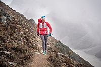 Running up Cho La Pass in a snow storm, the second pass of the 3 Passes Tour, Khumbu Valley, Nepal.