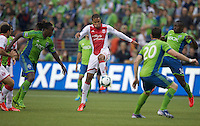 Ryan Johnson gets control of the ball in front of Shalrie Joseph, left, of the Seattle Sounders FC and Jhon Kennedy Hurtado of the Seattle Sounders FC during play at CenturyLink Field in Seattle Saturday August, 3, 2013. The Sounder won the match 1-0.