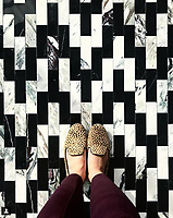 Floor: Ziggurat Grand mosaic in polished Plumeria and Nero Marquina, is part of the Tissé™ collection for New Ravenna