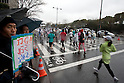 Feb. 28, 2010 - Tokyo, Japan - Fans cheer on the runners taking part in the 2010 Tokyo Marathon. Despite the cold and rain, more than 30,000 athletes participated in the event.