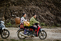 Giang A Tru and his wife Tan Thi Si, who are black cardamom (Thao Qua) farmers, driving to Hoang Lien Son National Park to harvest their crops.
