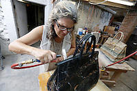 "Sculptor/Artist Barbara Segal works on her stone Birkin bag creation, ""Black Candy,"" out of her home studio, Yonkers, NY, Thursday, August 31, 2016."